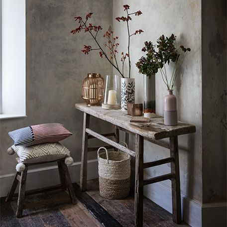 Vases with flowers on a sideboard