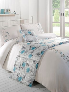 Linea Ribbon floral bed in a bad in aqua