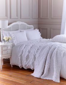 White broderie bed linen