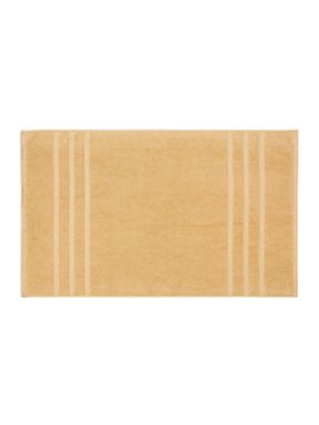 Christy Plush towels in soft gold