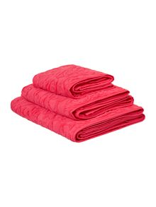 Heavy jacquard towels in coral