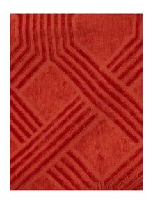 Geometric jacquard towels in rust