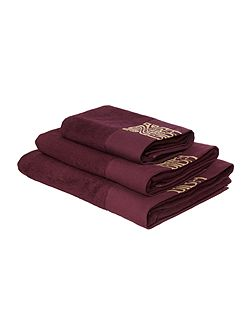 Gold logo bath towel in plum and gold