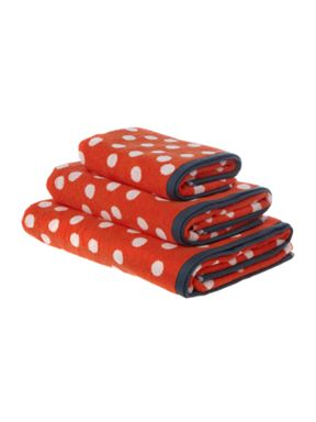 Dickins & Jones Orange polka dot bathing range