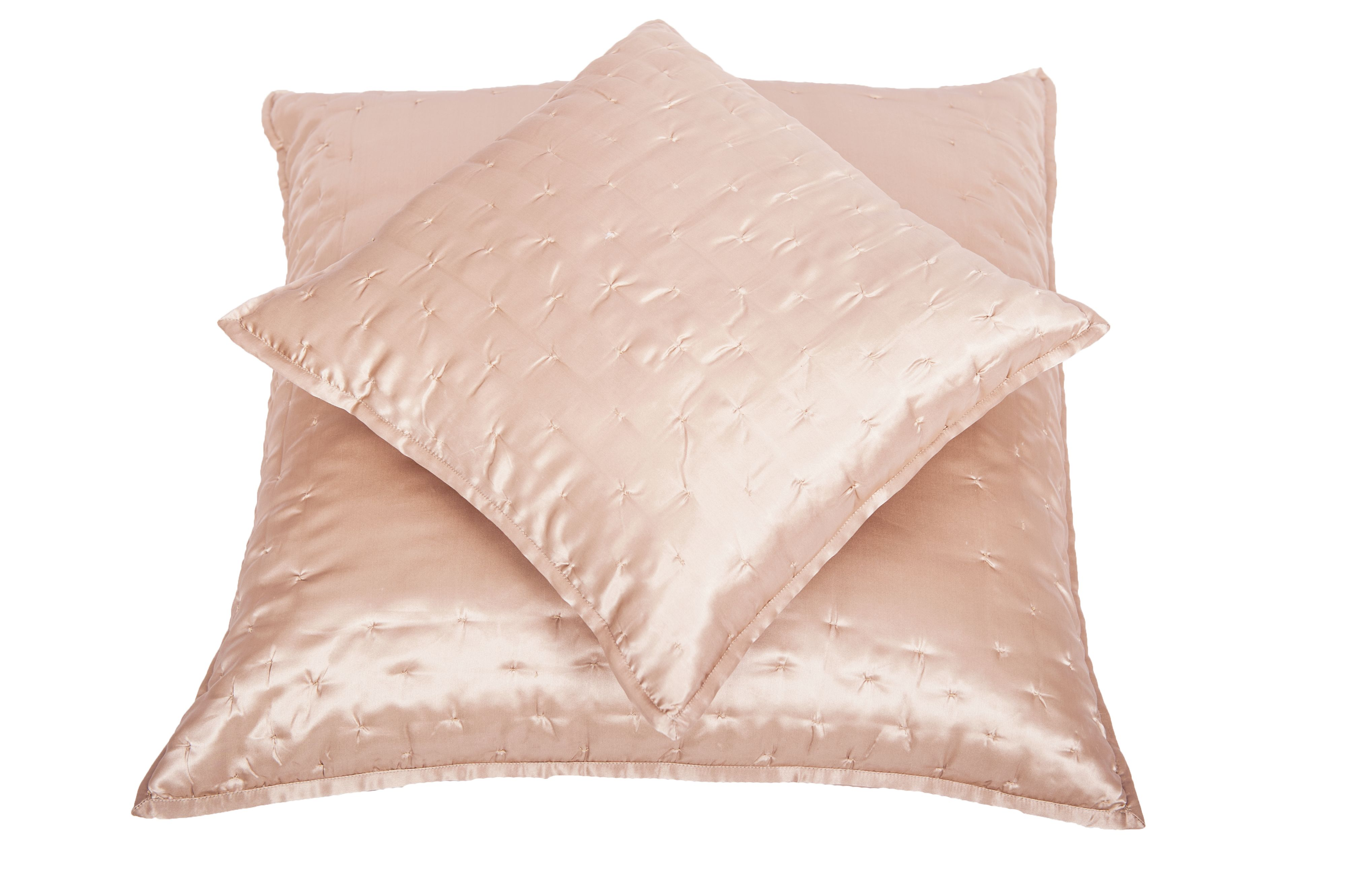 Dimple bedspreads and cushions in nude