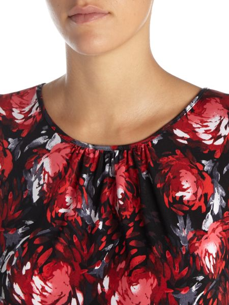 Tahari ASL Sleeveless top with a beautiful floral design.