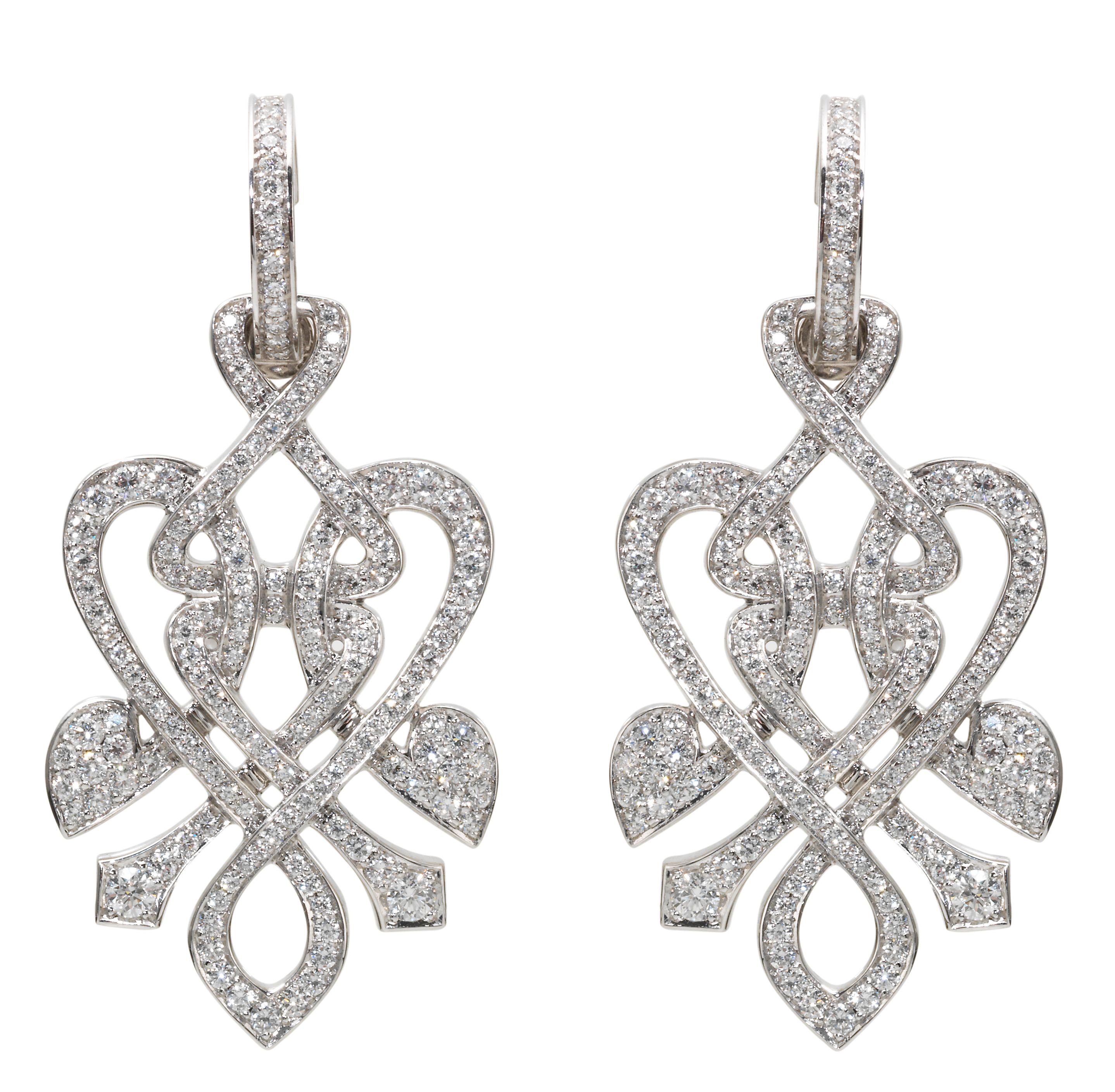 White gold and diamond heart twist drop earrings