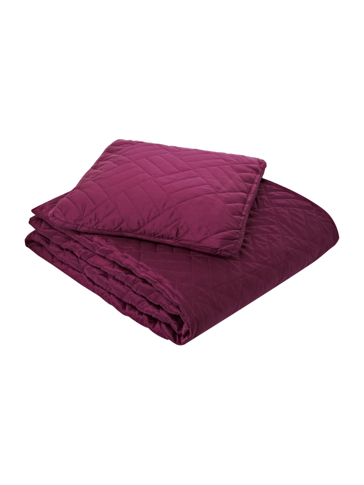 Quilted bedcover and cushion in plum