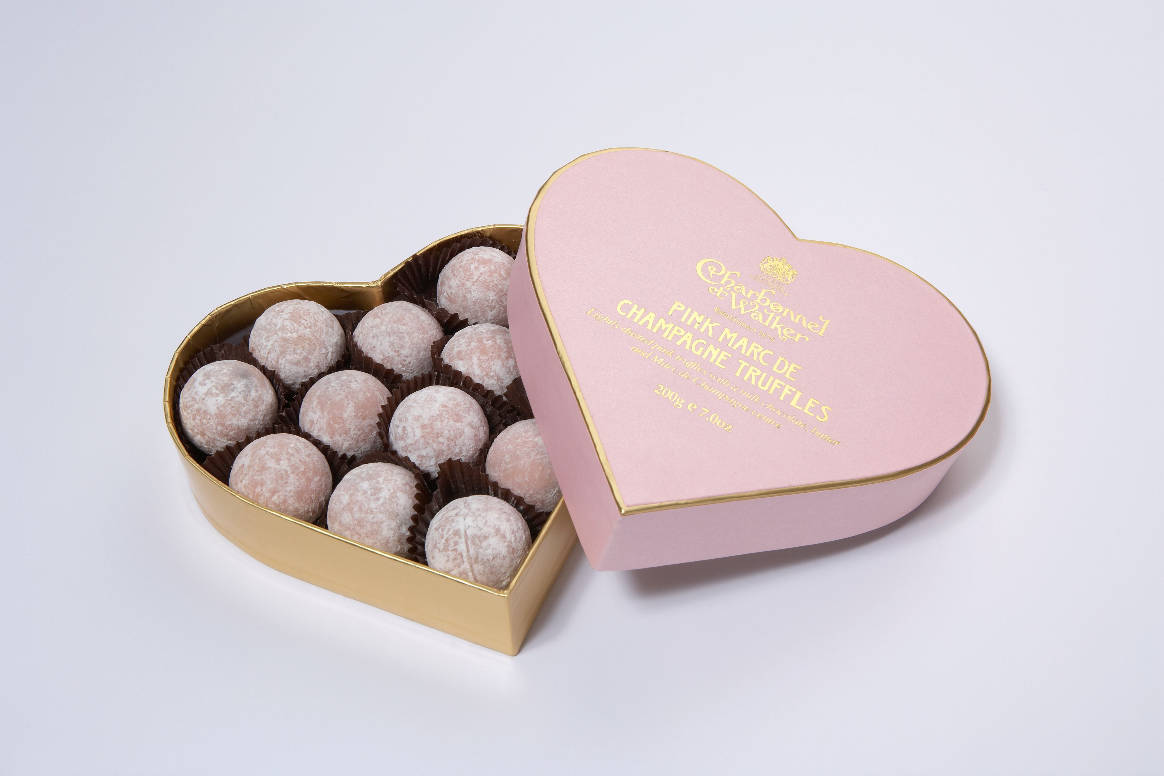 Pink Marc de Champagne truffles in a heart box