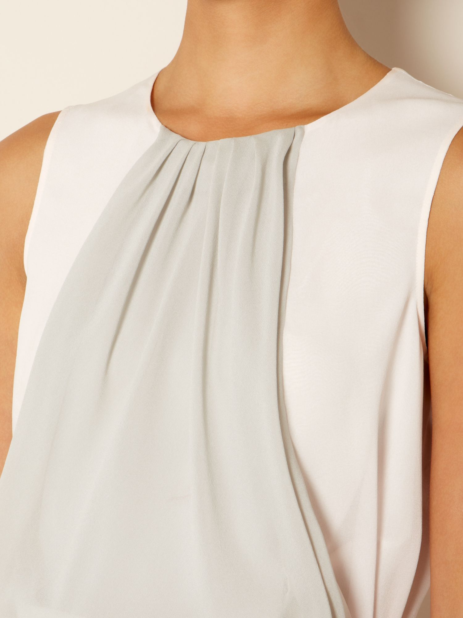 Laser sleeveless panelled top