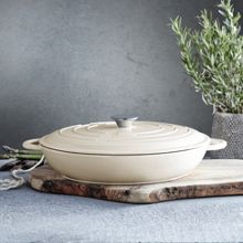 Cream cast iron low round casserole, 31cm