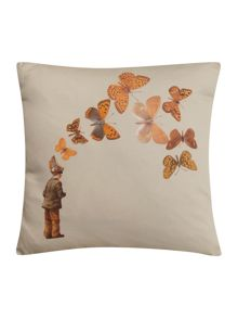 Boy with butterfly cushion