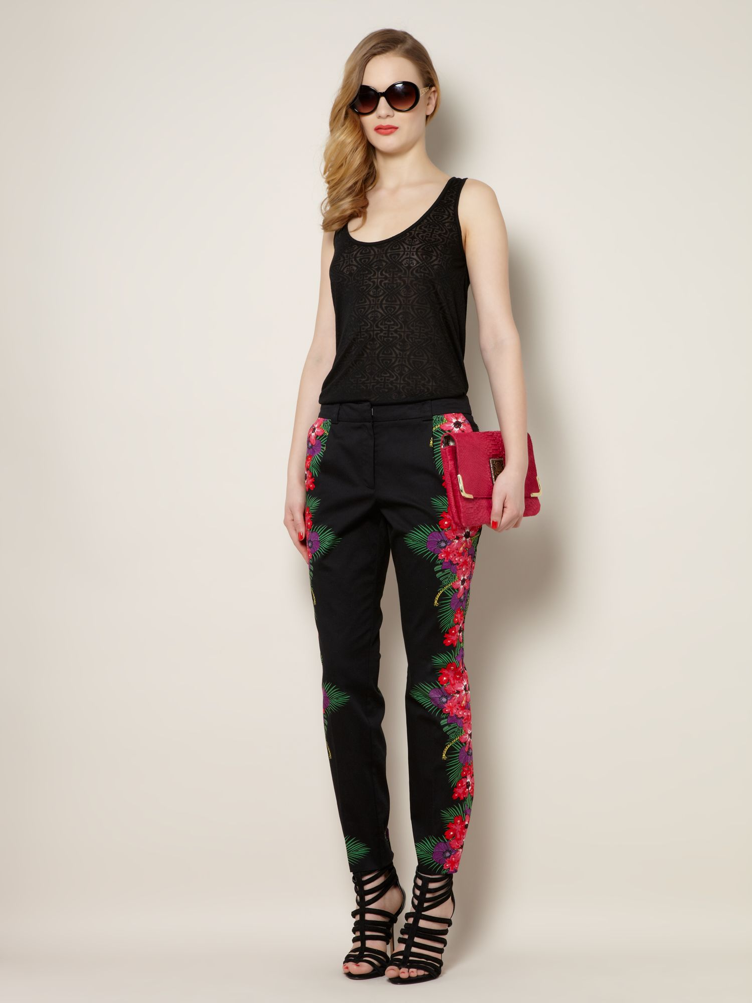 Tropical border print slim leg trousers