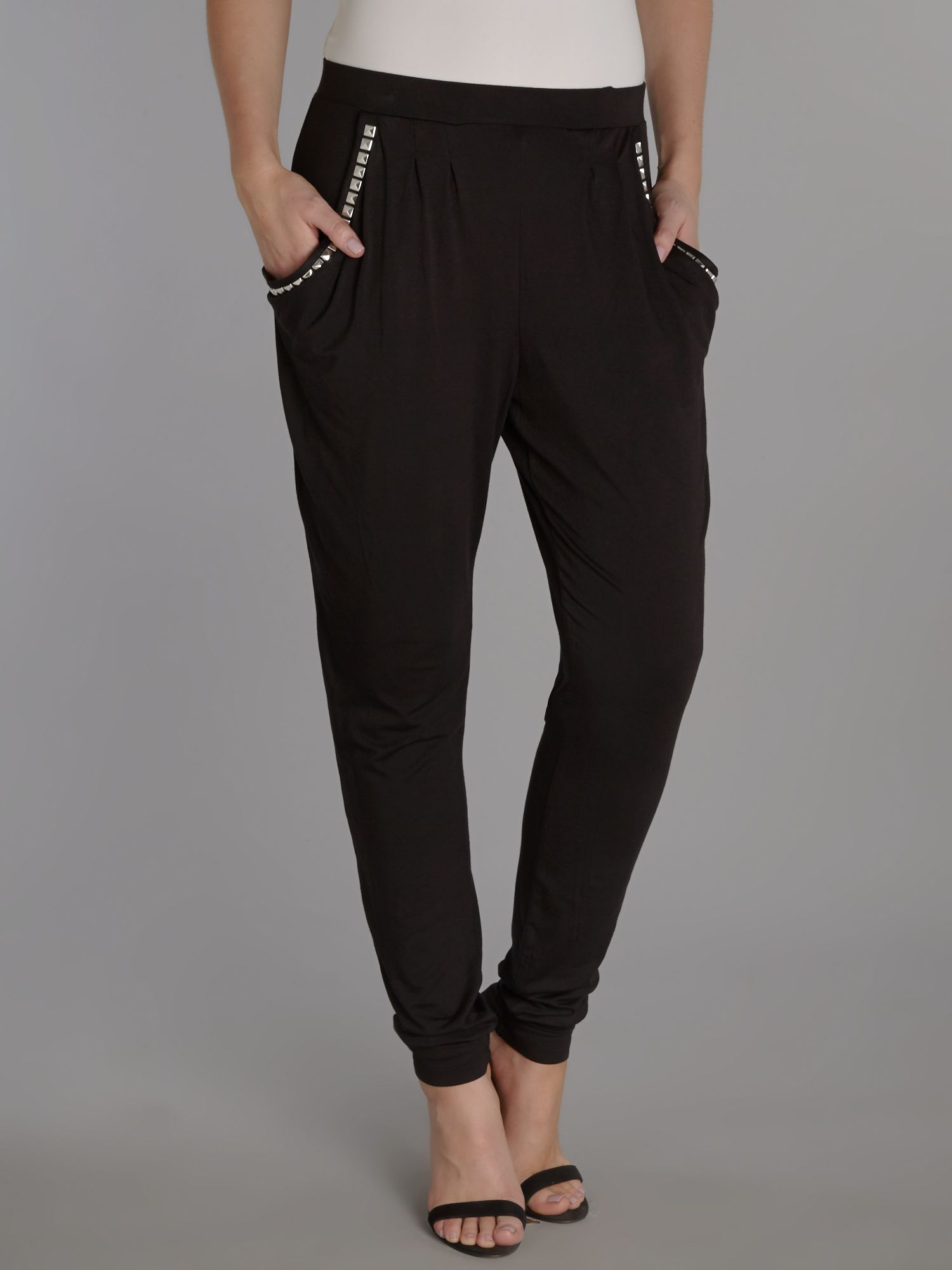 Slim fit trousers with studded pockets