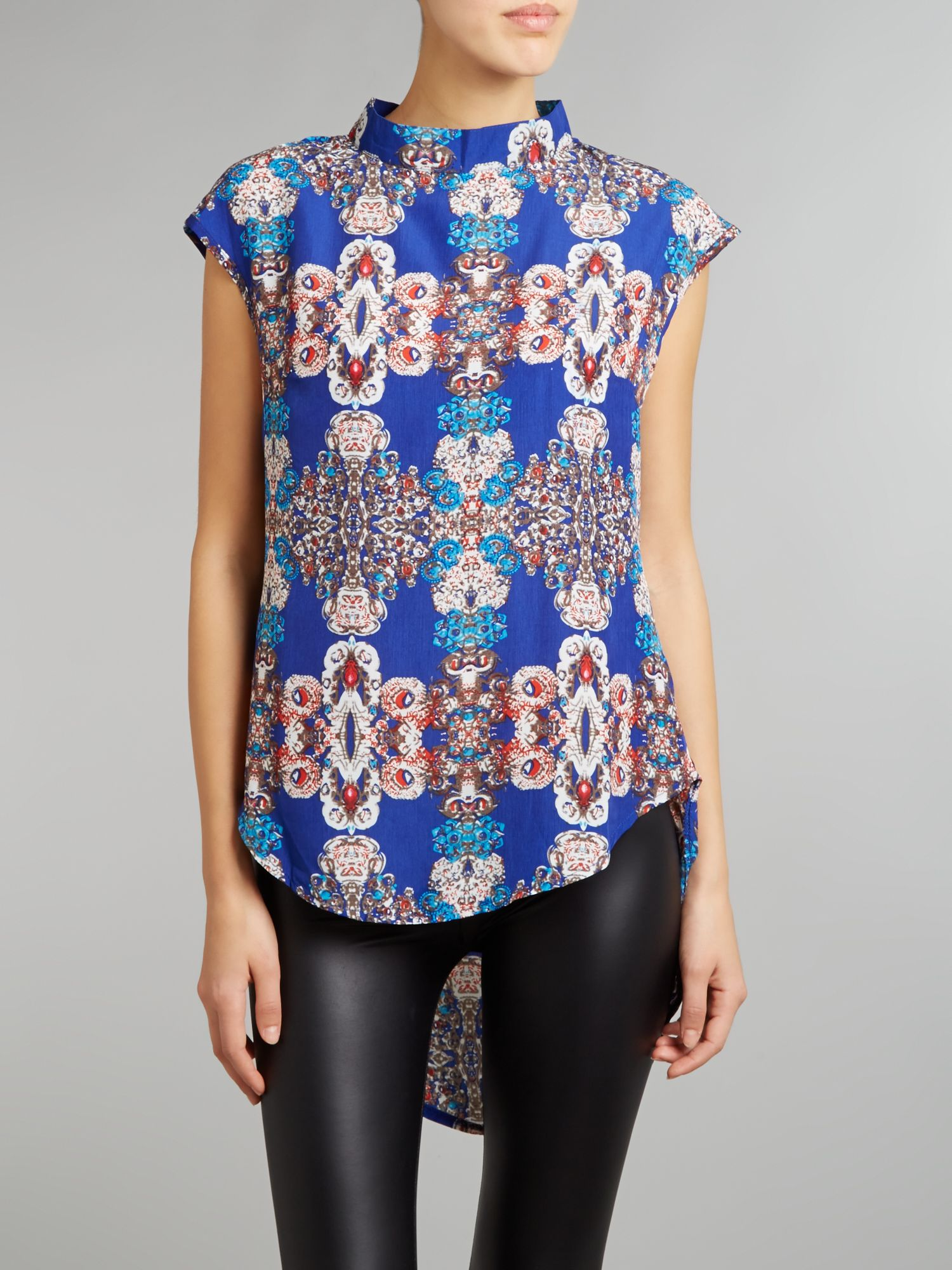 Printed turtle neck dip hem tunic top