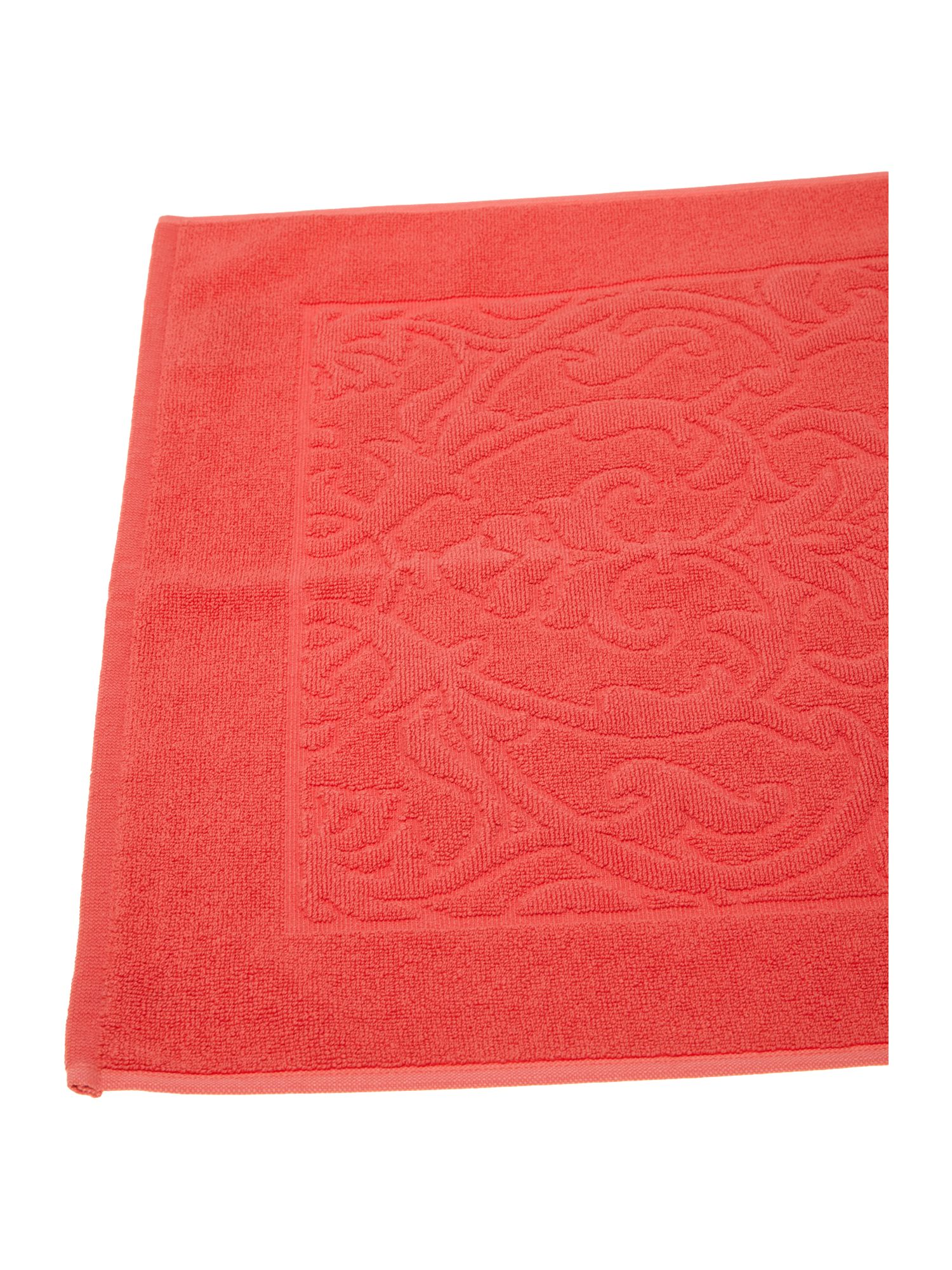 Heavy jacquard bath mat in coral