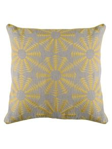 Polygon chartreuse cushion on natural linen.