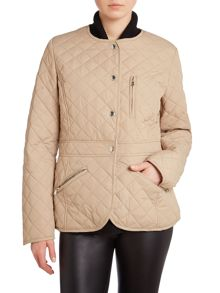 Collarless quilted peplum coat