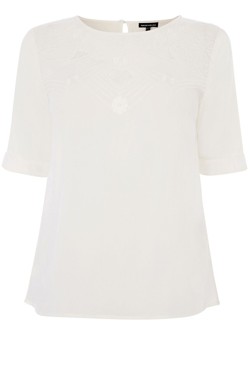 Embroidered neckline top