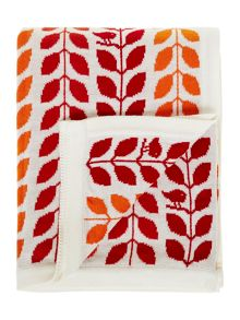 Leaf design knitted throw, oranges
