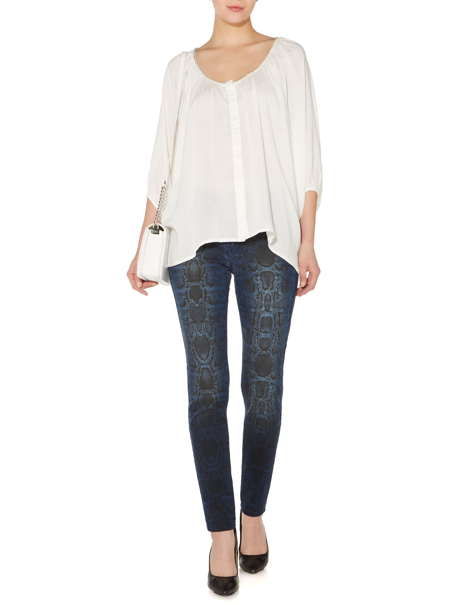 Snake print washed jeans