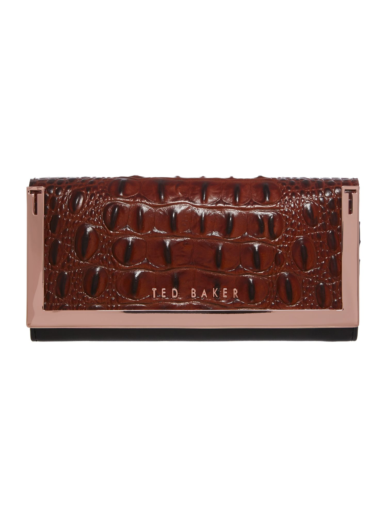 Tan metal bar flapover purse
