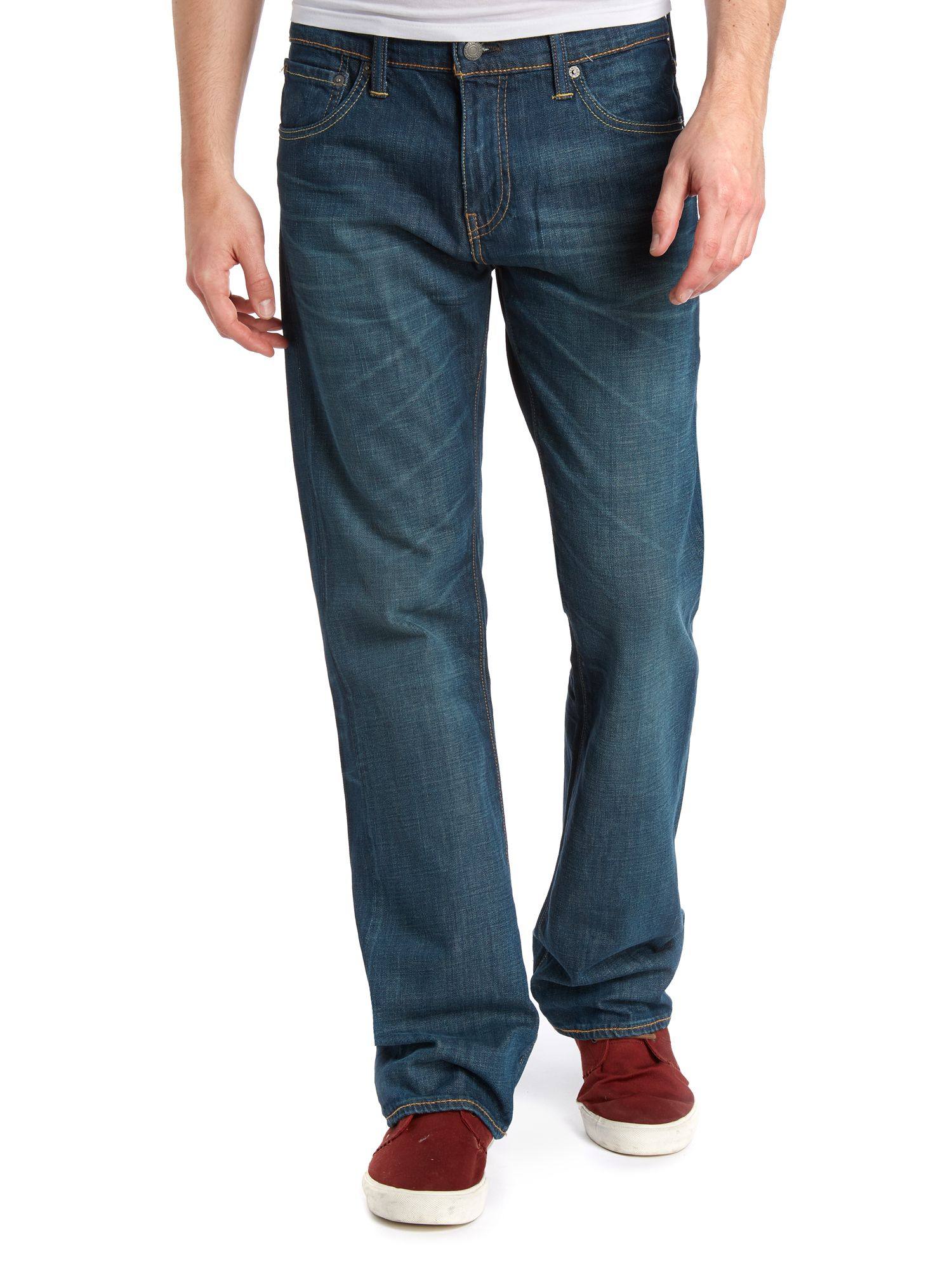 527 explorer mid wash boot cut jeans