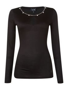 Long sleeve top with an embellished neck