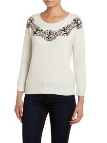3/4 sleeve knit top with an embellished neck