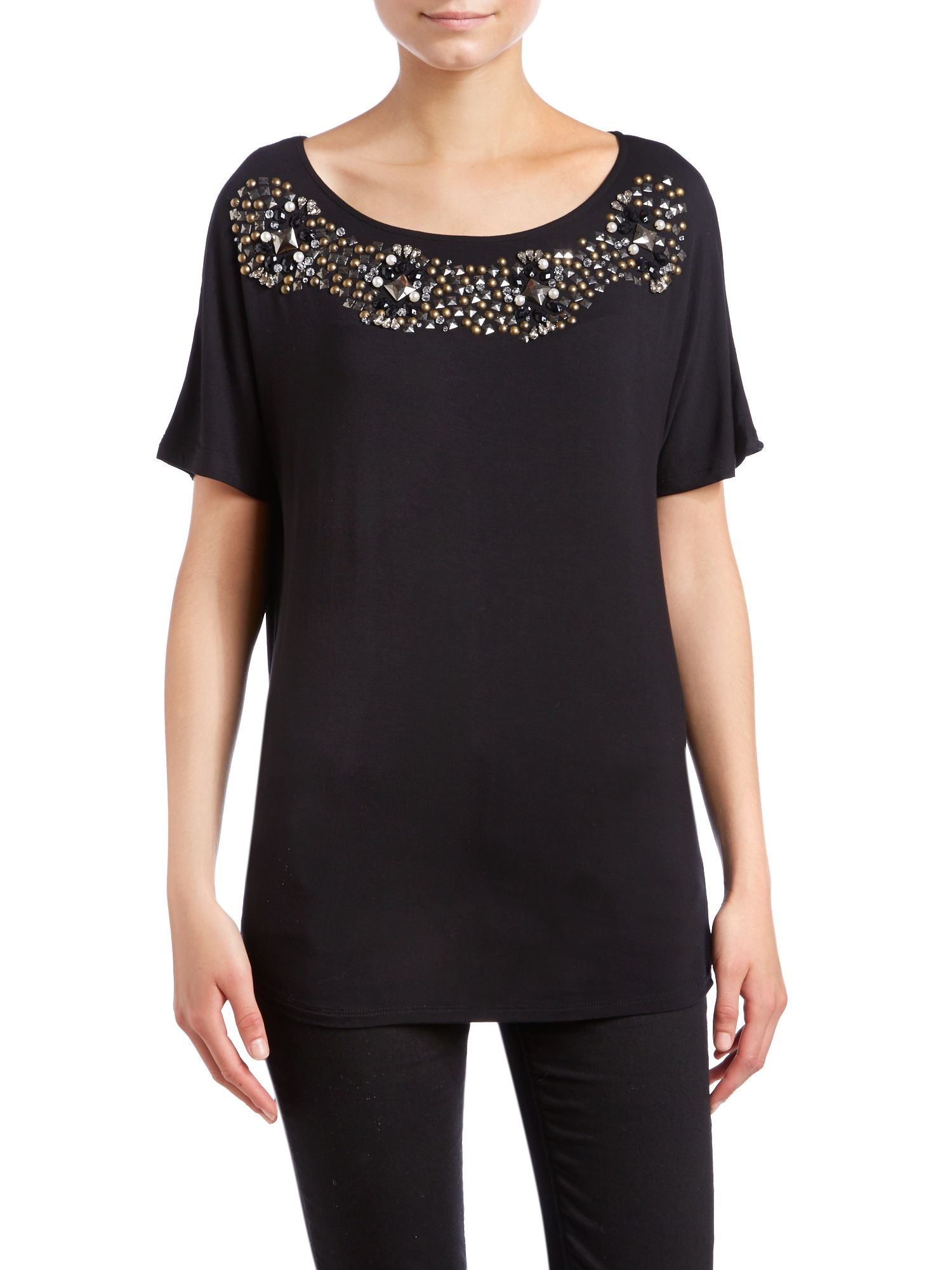 Short sleeve top with an embellished neckline