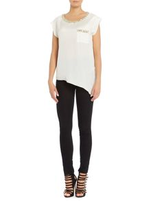 Short sleeved top and asymmetric embellished neck
