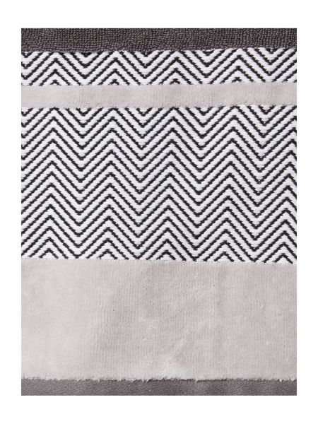 Living by Christiane Lemieux Chevron Border Hand Towel in Grey