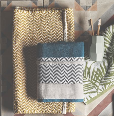 Living by Christiane Lemieux Chevron Border Hand Towel in Teal