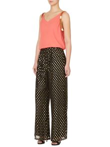 Spot printed wide leg trousers