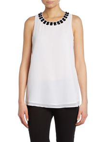 Sleeveless top with an embellished neckline