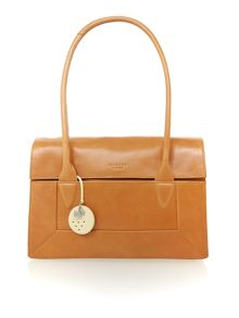 Border tan medium flap over tote bag