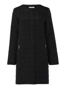 Transitional edge to edge quilted coat