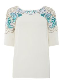 Embroidered button back blouse