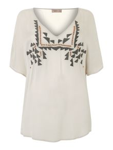 Embroidered cross back vee blouse