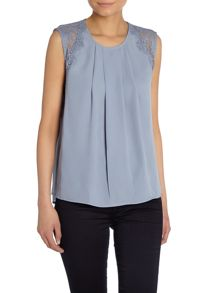 Sleeveless pleat front lace detail top