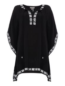Kaftan with embroidered border