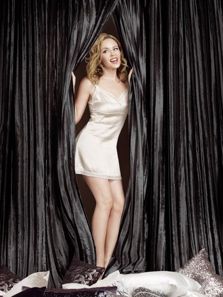 Kylie Minogue Iliana lined eyelet curtain in black 90x90