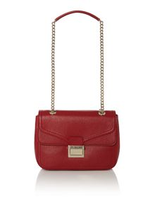 Red flap over shoulder bag