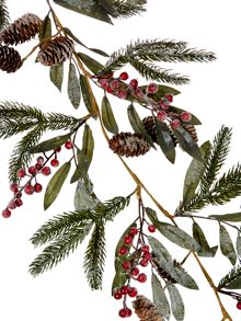Snow dusted garland with pine cones & red berries