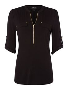 Shirt with zip neck and pockets