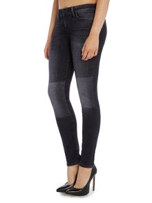 711 mid waist skinny jean in overflow patched