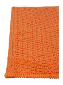 Linea Cotton bobble pedestal mat in orange