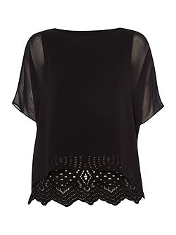 Sheer blouse with lace underlay
