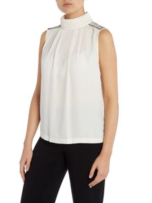 Sleeveless high neck blouse with shoulder detail