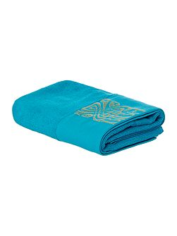 Gold logo hand towel in teal